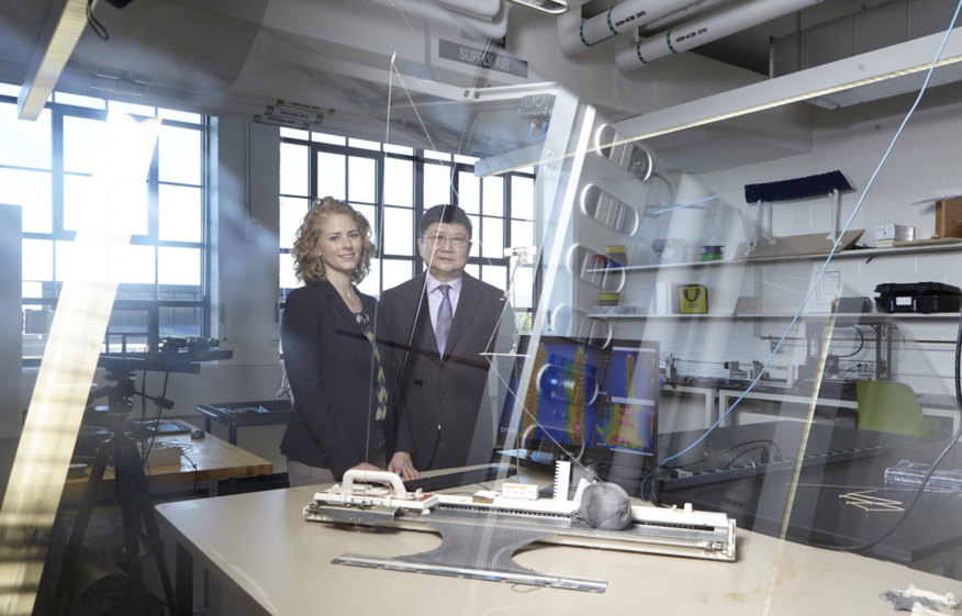 Julianna Abel and David Pui in a research lab.
