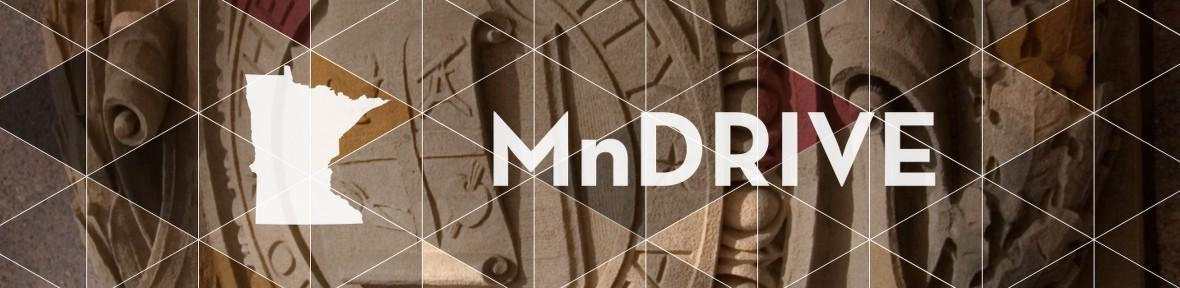 MnDRIVE logo overlay on top of a photo of the University of Minnesota seal